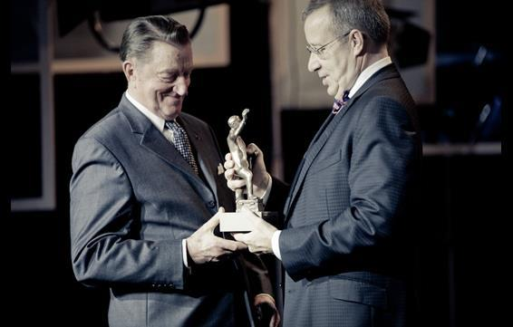 Estonian  President Toomas Hendrik Ilves hands the 'Best Estonian Film of All Time Award' to 'Kevade' director Arvo Kruusement